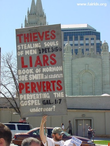 An anti-Mormon protester at April 2004 LDS General Conference criticizes the LDS use of the temple garment.