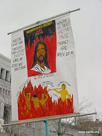 A protester at the April 2003 LDS General Conference attempts to convince others that members of the Church do not believe in the Biblical Jesus.  Members of the Church may believe some different things about Jesus, but this does not mean they worship a different being than the protester.